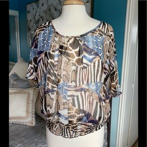 Cute blouse in mixed animal print